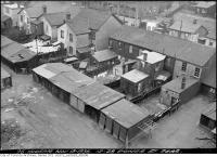 Historic photo from Friday, November 13, 1936 - Garages, laundry, and cars - 12-28 Power Street rear in Corktown