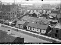 Historic photo from Friday, November 13, 1936 - Run down houses next to the Roman Catholic House of Providence just south of St. Pauls Basilica in Corktown