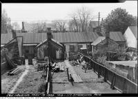 Historic photo from Friday, May 19, 1939 - Building materials and bricks out back of 109-117 Strachan Ave. in Stanley Park