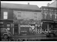 Historic photo from Friday, December 20, 1940 - 128 Ossington Avenue - cigarette ads for Vogue Fine Cut tobacco, Buckingham, Black Cat in Trinity Bellwoods