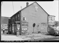 Historic photo from Saturday, July 26, 1947 - Lots of Cigarettes Ads at 67 Ossington Avenue in Trinity Bellwoods