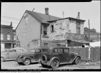 Historic photo from Saturday, July 26, 1947 - Falling-down house at 67 Ossington Avenue - building on left still there in Trinity Bellwoods