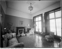 Historic photo from 1921 - Living room and grand windows at Woodlawn, east and north view in Summerhill