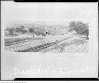Historic photo from 1924 - Cars, men, and pipe - Dufferin Street and Eglinton Avenue in Fairbank
