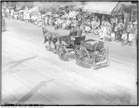 Historic photo from Friday, July 1, 1927 - No. 3 hose and chemical wagon in Centennial Parade, Bloor Street West seen from Bellair Street in Yorkville