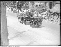 Historic photo from Friday, July 1, 1927 - No. 8 hose wagon in Centennial Parade, Bloor Street West seen from Bellair Street in Yorkville