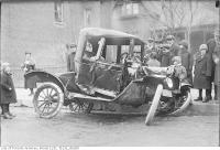 Historic photo from Monday, March 4, 1918 - Spectators and crashed car after auto accident No. 1042 Bloor Street West near Walmer Road in The Annex