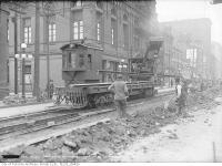 Historic photo from Sunday, April 29, 1917 - Queen Street West at Bond Street, streetcar tracking machine in Garden District