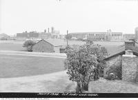 Historic photo from Friday, June 8, 1934 - Maple Leaf Baseball Stadium and Loblaws Groceteria Building beyond Old fort restoration in Fort York