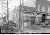 Historic photo from Friday, November 25, 1921 - John E. Atkinson flour and feed and hardware at 3160 Yonge Street - stop 24 in Bedford Park