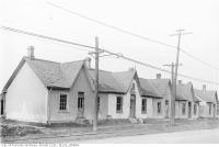Historic photo from Monday, November 21, 1921 - Row houses 2042-2052 Yonge Street, corner of Lola Road in Chaplin Estates