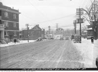 Historic photo from Thursday, January 13, 1938 - Winter view up Davenport Road north to Dupont Street and Imperial gas station in The Annex