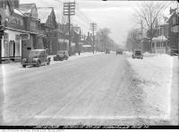 Historic photo from Thursday, January 13, 1938 - Snow and Duckworths Furs on Avenue Road looking north from Yorkville Avenue in Yorkville