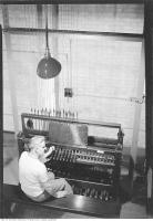 Historic photo from Thursday, June 1, 1939 - Man sitting at Hart House Tower carillon in University of Toronto (U of T)
