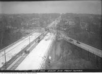 Historic photo from Monday, November 3, 1924 - New St. Clair bridge construction with old Avoca Avenue bridge still in use, birds eye view from tower looking west in Moore Park
