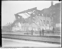 Historic photo from 1907 - Men viewing the demolition of fire remains at site of future Union Station in Financial District