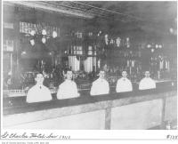 Historic photo from 1911 - St. Charles Hotel - five bartenders behind the bar in Downtown