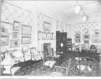 Historic photo from 1909 - Drawing room of Sir Joseph Wesley Flavelle Holwood house - lots of paintings and chairs in Queens Park