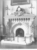 Historic photo from 1910 - Carved Osgoode Hall Law School Library fireplace with clock in City Hall