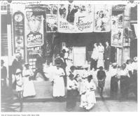 Historic photo from 1910 - Red Mill theater with crowd out front in Garden District