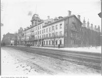 Historic photo from 1908 - Queen's Hotel looking west across Front Street in Financial District