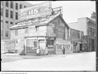 Historic photo from 1910 - Old Doel Brewery - Store plastered with signs, northwest corner of Adelaide Street West and Bay Street in Downtown