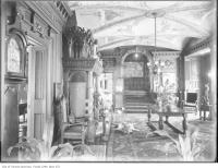 Historic photo from 1910 - Front hall of the Flavelle residence with amazing woodwork, vaulted ceiling, and grandfather clock in Queens Park