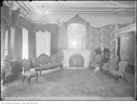 Historic photo from 1911 - Drawing room with ornate  woodwork and wallpaper (Queens Hotel) in Financial District