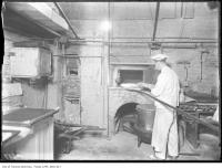 Historic photo from 1908 - Baker making fresh bread at the  Queens' Hotel in Financial District