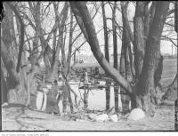 Historic photo from 1909 - Gwynne Estate - children play near a pond with view east to Dufferin Street in Parkdale