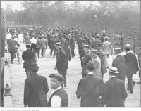 Historic photo from 1910 - Saturday afternoon lacrosse match crowds crossing the Old Glen Road bridge in Rosedale