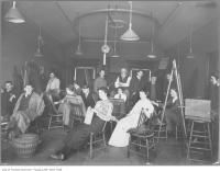 Historic photo from Sunday, April 9, 1911 - Life drawing class, Ontario School of Art, The Grange Behind the easel is the artist George Reid in Art Gallery of Ontario