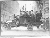 Historic photo from Monday, November 11, 1918 - Kids celebrating WWI Armistice Day, Bay and King streets in Downtown