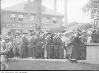 Historic photo from 1918 - Munitions workers line up for last pay, southeast corner of King and Dufferin streets across from Metallic Roofing Co in Liberty Village