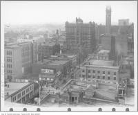 Historic photo from 1910 - Aerial view up Bay Street from King Street past Doels Homestead and Brewery with signs in Downtown