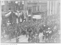 Historic photo from Monday, November 11, 1918 - WWI Armistice Day - crowds outside Star Building at 18 King Street West in Downtown