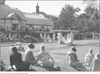 Historic photo from 1926 - Wedding fashion parade at Ardwold in front of glassed in conservatory and indoor pool in Casa Loma