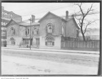 Historic photo from 1908 - Berkeley House, King Street East and Berkeley St. - log cabin built 1794, Gothic style windows and stucco added, demolished in 1920s in Corktown