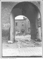 Historic photo from 1911 - Tabezzo Enamelling sign on archway at the back entrance to old Upper Canada College building - broken windows, garbage in King Street West