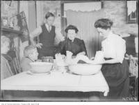 Historic photo from Sunday, December 25, 1910 - James family making Christmas pudding - Norman, Frank, Joe, Mother, Sis. (from left to right) in Grange Park
