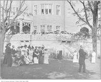 Historic photo from 1914 - Garden party on the grounds outside with Lady Pellatt in the wheelchair in Casa Loma