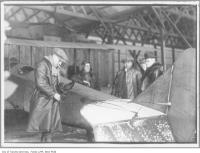 Historic photo from 1916 - Bert Acosta prepares to take William James Sr. just before he took the first movies from the air in Canada in Leaside