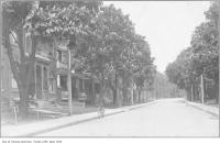 Historic photo from 1910 - 250 Major Street, looking north to Bloor Street w/ Norm and Frank James on porch in Harbord Village