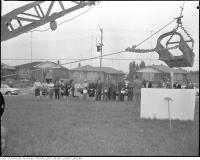 Historic photo from 1954 - Shovel holding sign for sod turning ceremony, Nelson A. Boylen Secondary School in Maple Leaf