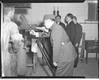Historic photo from Friday, February 27, 1942 - Major General Whang Ping-hing inspecting Bren gun during visit of Chinese officials to John Inglis Co., Ltd. in Liberty Village