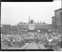 Historic photo from Friday, August 20, 1943 - Band waiting in shorts at the 100,000th Bren gun ceremony, John Inglis Co., Ltd. in Liberty Village