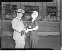 Historic photo from Friday, August 20, 1943 - Chinese General P. Kiang and June Pattison, Miss Inglis, posing with Bren gun outside plant at 100,000th Bren gun ceremony, John Inglis Co., Ltd.  in Liberty Village