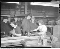 Historic photo from Monday, January 24, 1944 - Lord Halifax and to his left Major J E Hahn  watching female war workers at John Inglis Co., Ltd. in Liberty Village
