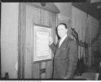 """Historic photo from 1950 - \""""Spiff\"""" Evans pointing to framed Civitan Creed in Don Mills"""