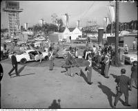 Historic photo from Friday, August 27, 1965 - Firing cannon to start CNE with Wild Mouse, clock tower in distance in CNE